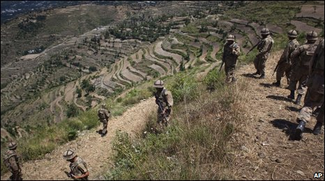 Pakistani army soldiers patrol in the Biha valley following an intense operation against Taliban strongholds in the upper Swat Valley