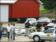 Investigators at Aplington-Parkersburg High School after a gunman attacked sports coach Ed Thomas, 24 June 2009