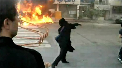 Woman throwing missiles on streets of Tehran