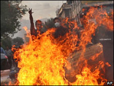 Opposition protesters behind burning barricades in Tehran. Photo: 20 June 2009