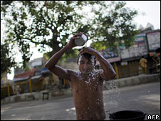 A man bathing in Delhi which is in the grip of a severe heat wave