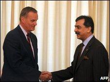 "Pakistani Prime Minister Yousuf Raza Gilani (R) shakes hand with President Barack Obama""s top security adviser James Jones"