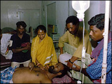 A sun stroke victim being treated in Orissa