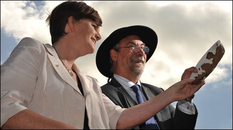 Education Minister Caitriona Ruane and Archaeologist Kev Beachus examine one of the artefacts found
