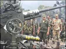 This undated handout picture released by the Sri Lankan Army on May 17, 2009, shows what they claim are government troops inspecting a heavy weapon captured from Tamil Tiger guerrillas in northeastern Mullaittivu district.