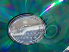 CD being put in computer, BBC