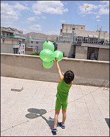 Photo sent to BBC Persian of a boy releasing ballons