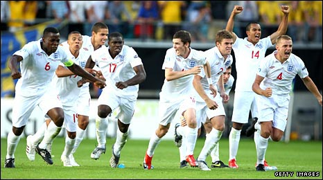 England players run to celebrate after the decisive penalty