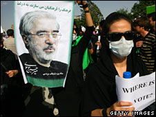 A protester holds a portrait of Mr Mousavi at a demonstration in Tehran on 18 June