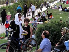 Iranian families enjoy their weekend as they picnic at a park in Tehran on June 26, 2009