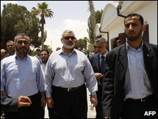 Hamas leader Ismail Haniya (C) visits Rafah crossing 27 June