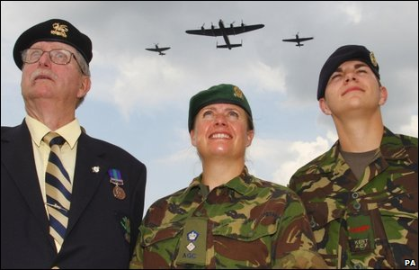 Army veteran Bruce Bishop, Lt Col Lesley Wilde and RSM Lee Swallow watching an air display