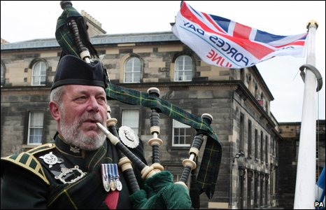 Piper John Mackintosh looks on as the Armed Forces Day flag is raised at Edinburgh City Chambers ahead of the Armed Forces Day.