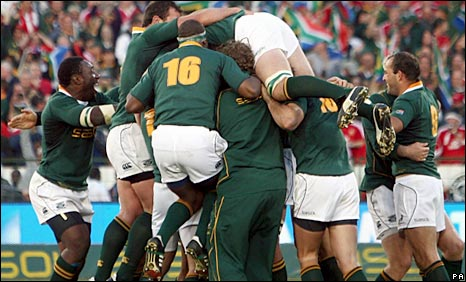 South Africa celebrate after Steyn's monster kick from inside his own half gives them a dramatic victory