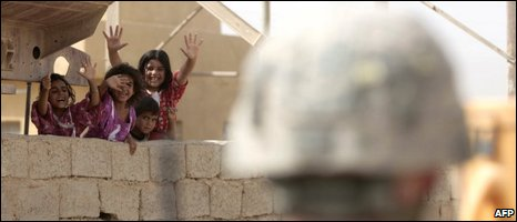 raqi children wave to US soldiers in Khan Bani Saad, 27/06