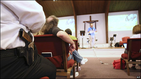 Gun-toting parishioners listen to Pastor Ken in church