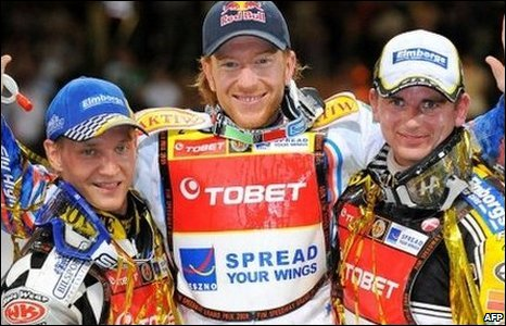 Fredrik Lindgren, Jason Crump (winner) and Hans Andersen celebrate finishing in the top three
