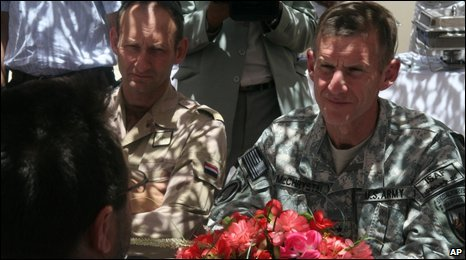 McChrystal, right, meets an Afghan governor in Helmand, June 2009