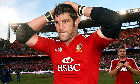 Simon Shaw looks distraught as he leaves the field after the match