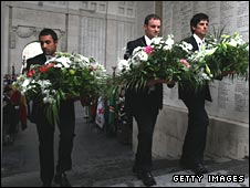 England cricketers Ravi Bopara (L) Andrew Strauss (C) and Alastair Cook prepare to lay wreaths at The Menin Gate in Ypres