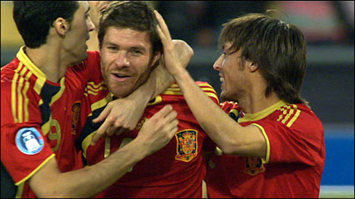 Spain players congratulate Xabi Alonso