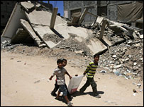 Boys walk through the Rafah refugee camp in Gaza on 28 June 2009