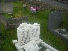 Damaged grave stone