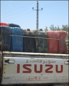 A pick-up truck loaded with fuel makes its way to Rafah