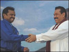 Vinyagamoorthi Muralitharan (left) is sworn in by President Rajapksa