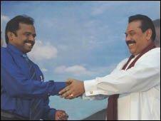 Vinyagamoorthi Muralitharan (left) is sworn in by President Rajapksa