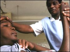 A nurse attending to a patient in Zambia