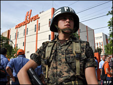 An Honduran soldier stands guards in front of the National Telecommunications Institution which has been occupied by the military following the removal of President Manuel Zelaya