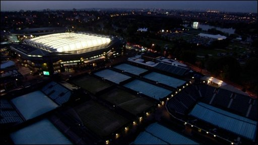Wimbledon's centre court lit up by lights