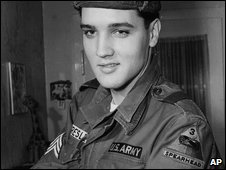 Elvis Presley in his army uniform in 1960