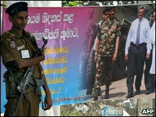 A Sri Lankan soldier stand guard beside a banner, showing a photograph of Sri Lankan President Mahinda Rajapakse (R in banner) with his Defence Secretary and brother Gotabhaya Rajapakse (C) and Sri Lankan Army chief Lieutenant General Sarath Fonseka (L), in Colombo on May 19, 2009