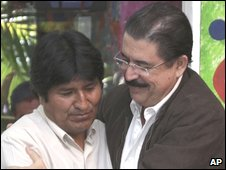 Ousted Honduran President Manuel Zelaya (right) embraces Bolivian President Evo Morales in Managua on 29 June 2009