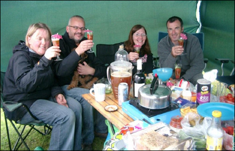Members of WELTAF (Welsh Terriers and Friends) enjoy a late-night drink while camping near Bala.