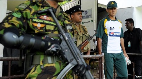 "Sri Lankan security personnel stand guard as Pakistan""s cricketer Abdul Razzaq (R) arrives for a practice match in Colombo on June 29, 2009."