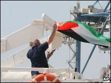 Free Gaza Movement member hangs Palestinian flag on the boat