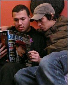 The band reading guitar magazine