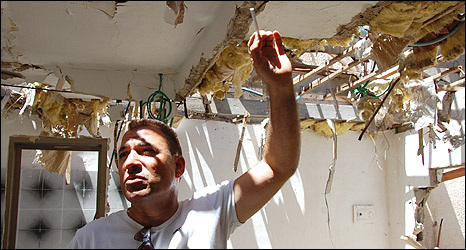 Avi Maman in his ruined house, hit by a Palestinian rocket, Sderot