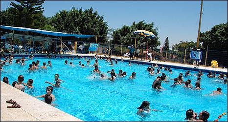 Children play in Sderot swimming pool