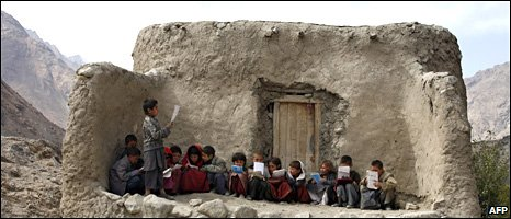 Afghan students recite Islamic prayers in a makeshift outdoor classroom in the remote Wakhan Corridor