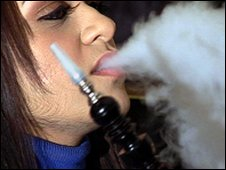A woman smoking a shisha