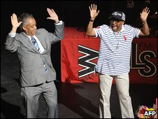 Al Sharpton and film director Spike Lee on stage at the Apollo Theater.
