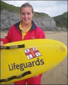 Surfing lifeguard Beth Mason