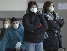 People wear masks at a hospital in Buenos Aires on 30 June 2009