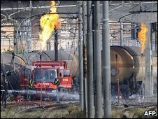 Firemen empty gas from crashed railway tankers in Viareggio, Italy