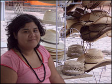 Vitoria sits outside her souvenir shop in Cancun
