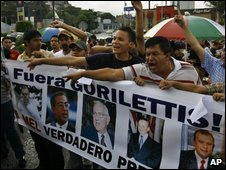 Supporters of President Zelaya demonstrate near the presidential palace on 30 June